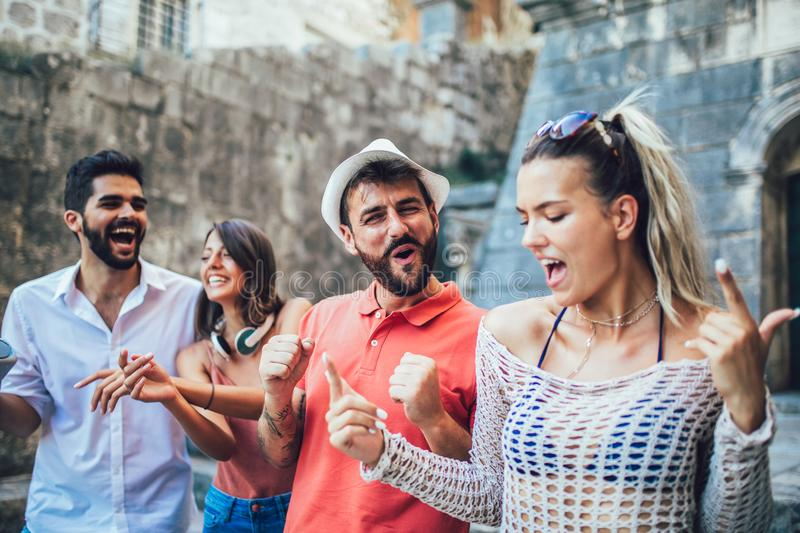 Young happy tourists sightseeing in city. stock photography
