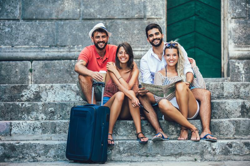 Young happy tourists sightseeing in city stock image