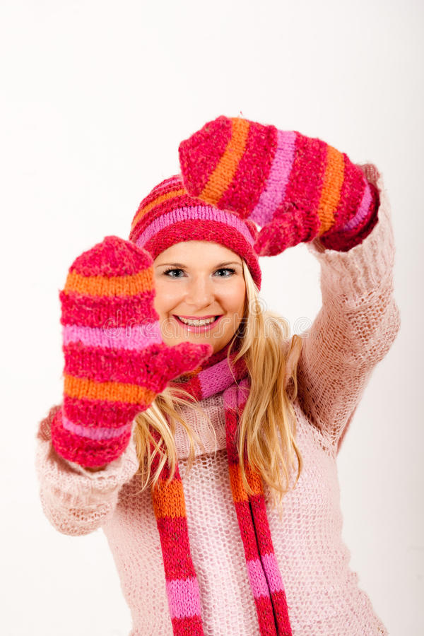 Young happy winter woman in pink gloves. Portrait of Young happy winter woman in pink gloves . gray background royalty free stock images