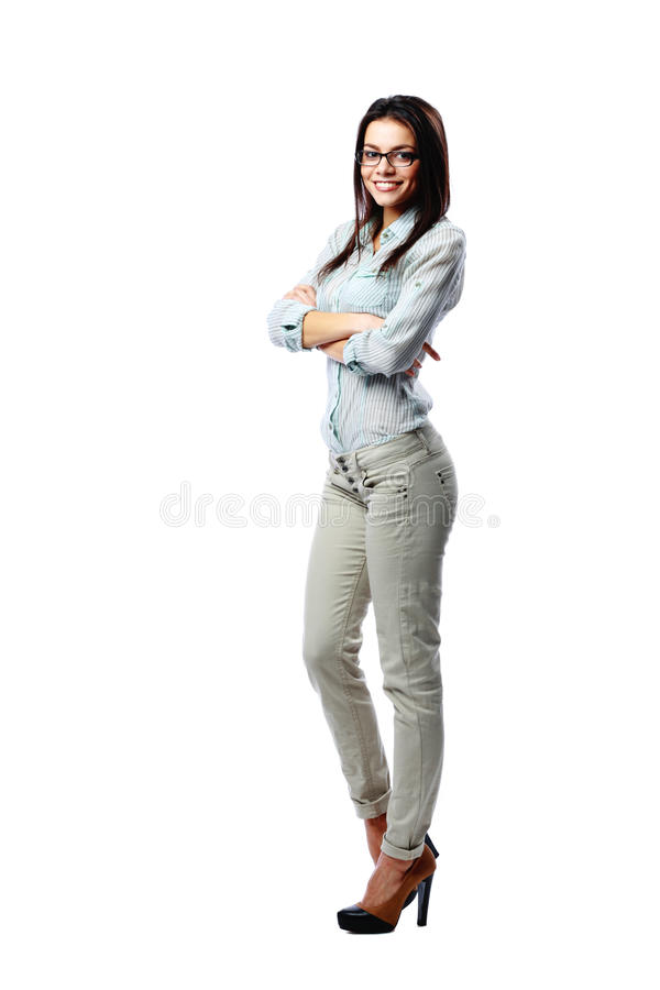 Young happy woman with arms folded. Full-length portrait of a young happy woman with arms folded isolated on white background royalty free stock images