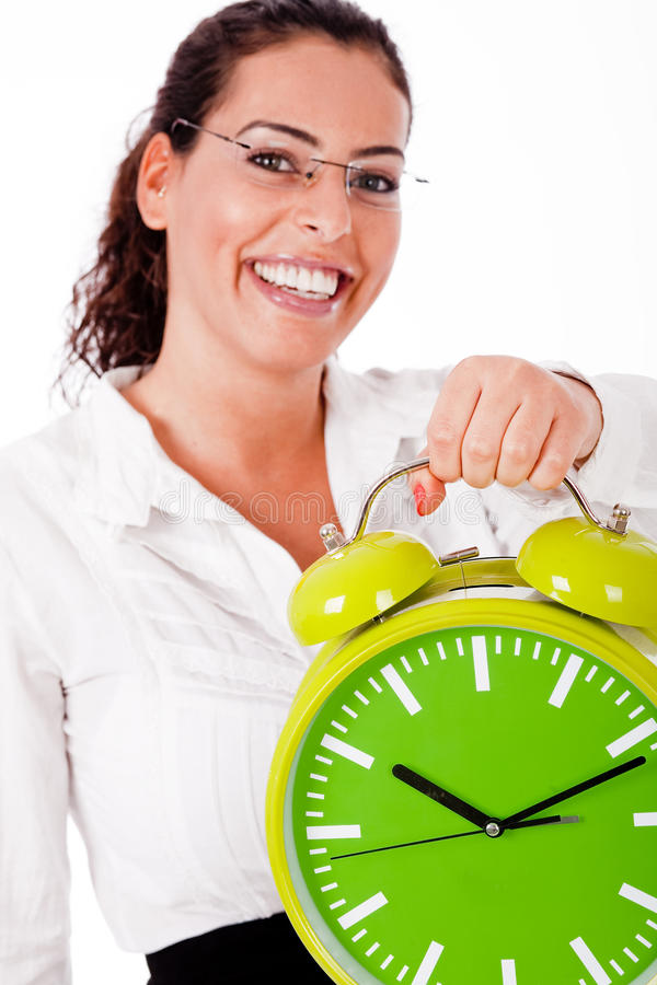 Young happy woman carrying a old clock stock photo