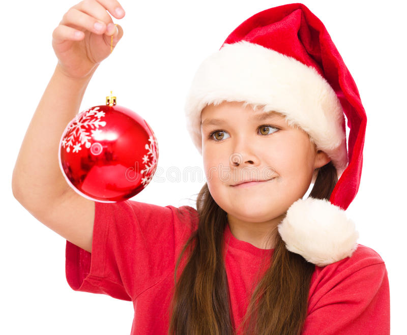 Young happy woman in christmas cloth. Young happy woman in santa cloth is holding a christmas decoration, isolated over white royalty free stock images