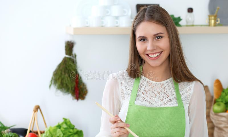 Young happy woman cooking in the kitchen. Healthy meal, lifestyle and culinary concepts. Good morning begins with fresh. Salad stock photography