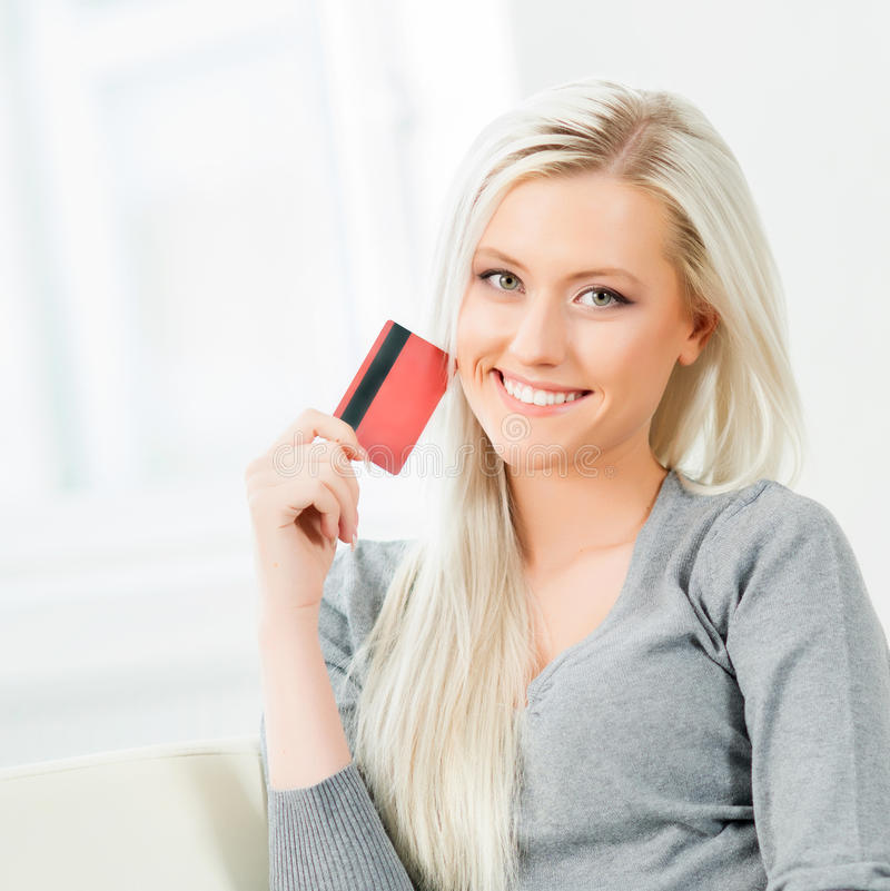 Young and happy woman with a credit card. Online shopping concept royalty free stock images
