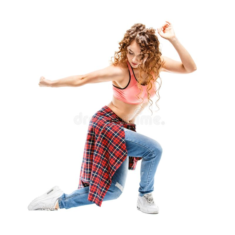 Young happy woman dancing against white background stock photos