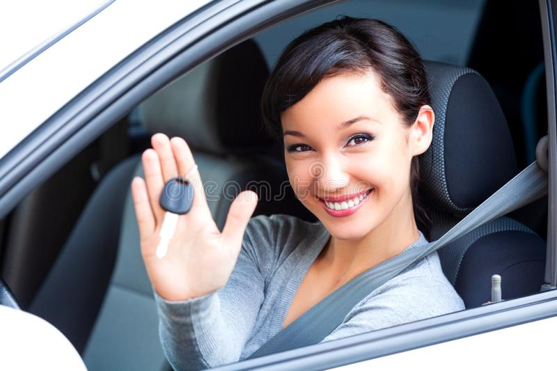 Woman driver hold car keys in her new car. Young happy woman driver hold car keys in her new car stock images