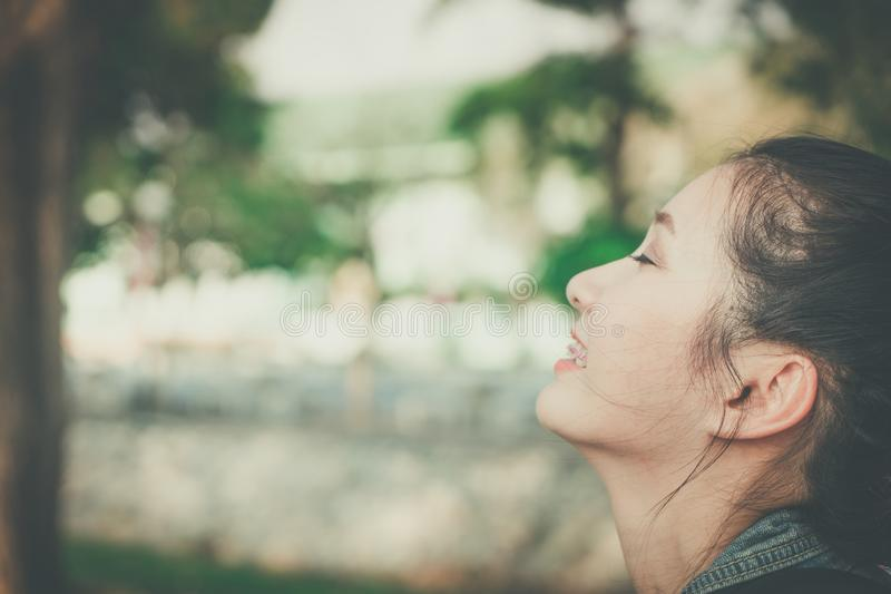 Young happy woman face smile with gum in nature take a deep breath feeling fresh. gums receding problem, oral dental care concept. stock photo