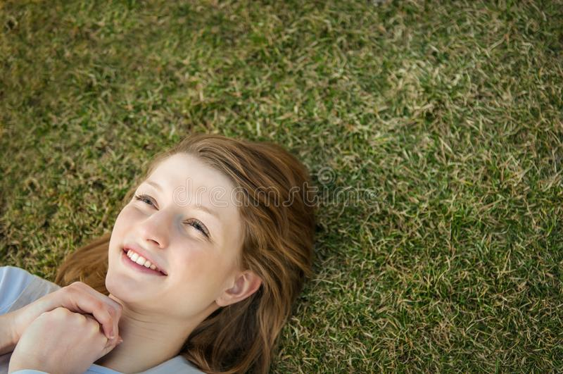 Young happy woman in grass stock images