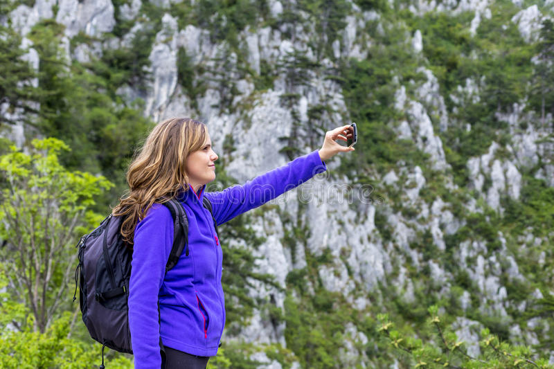 Young happy woman having fun outdoors taking selfie royalty free stock photo