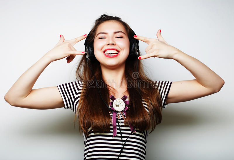 Young happy woman with headphones listening music royalty free stock photo