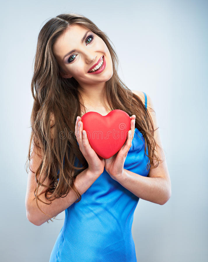 Young happy woman hold Love symbol red heart. on. Studio background female model stock image