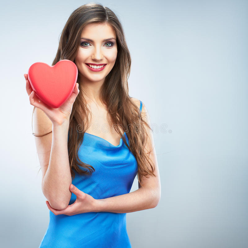 Young happy woman hold Love symbol red heart. on. Studio background female model royalty free stock photo