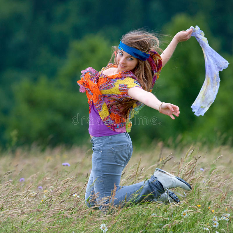 Young happy woman jumping stock image