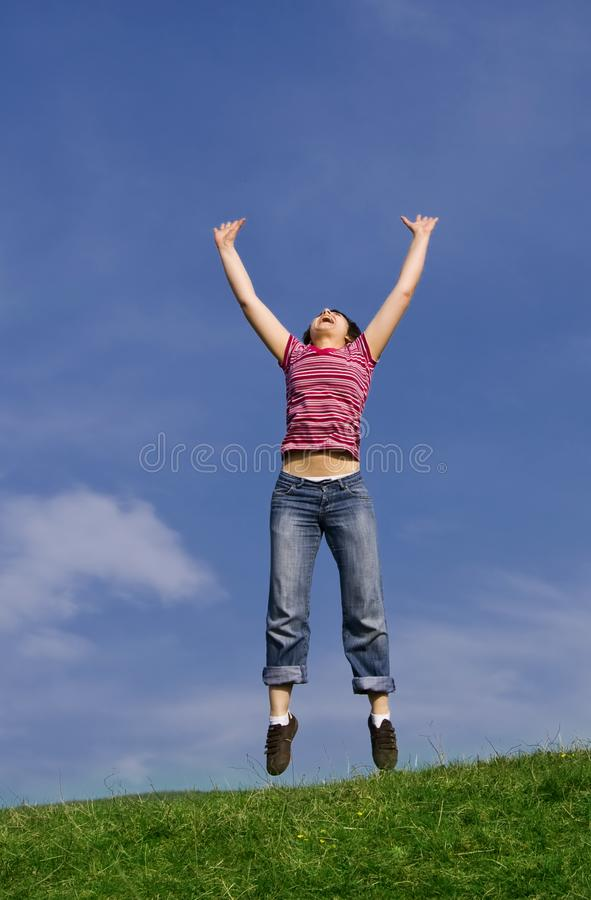 Young Happy Woman Jumping High Stock Images