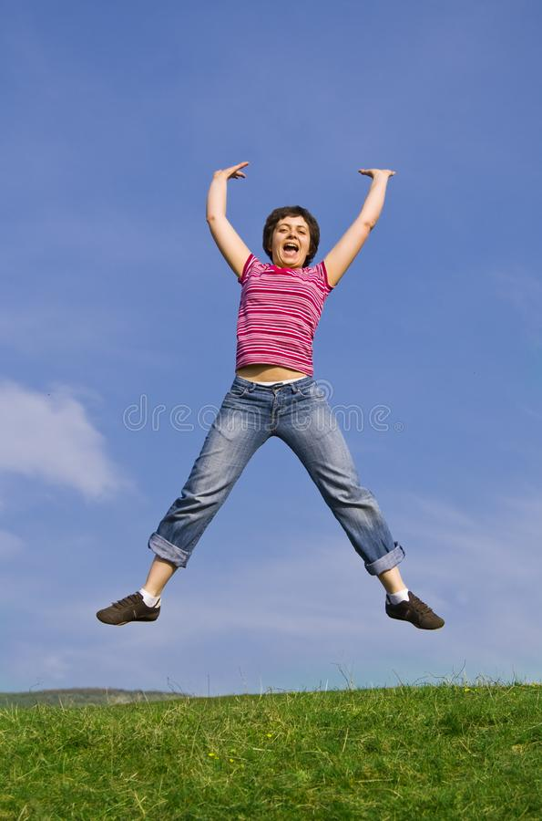 Young happy woman jumping high royalty free stock photo