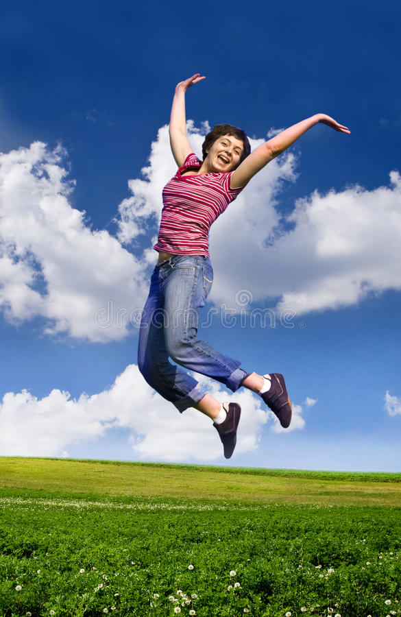 Young happy woman jumping high against blue sky. Young happy woman jumping high against blue summer sky stock photos