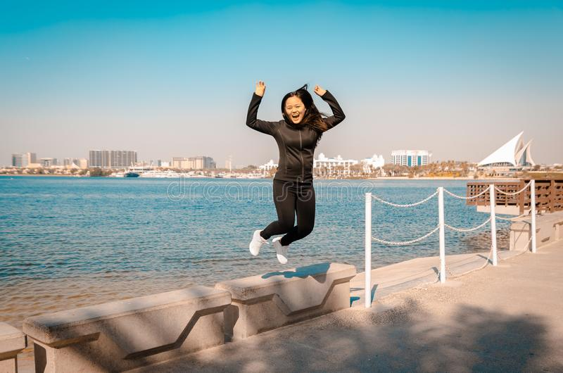 Young happy woman jumps in the air royalty free stock images