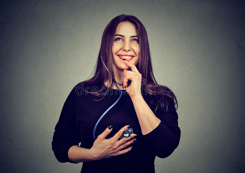 Young happy woman listening to her heart with stethoscope royalty free stock photography