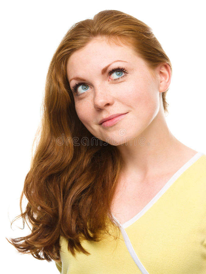 Young happy woman is looking up and smile. Young woman is looking up and smile, isolated over white royalty free stock photography