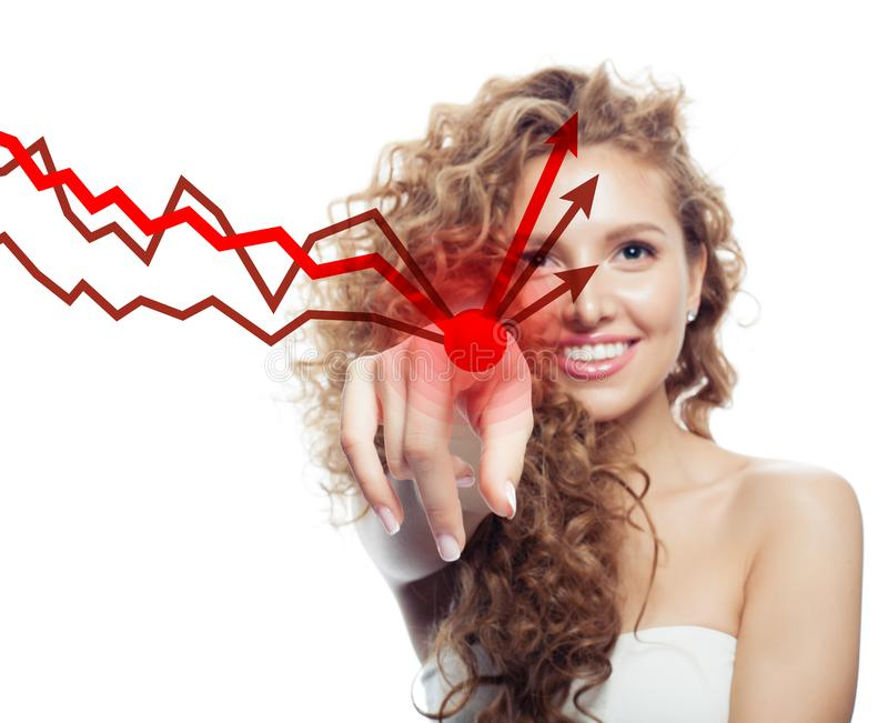Young happy woman pointing on red rising arrow stock photo