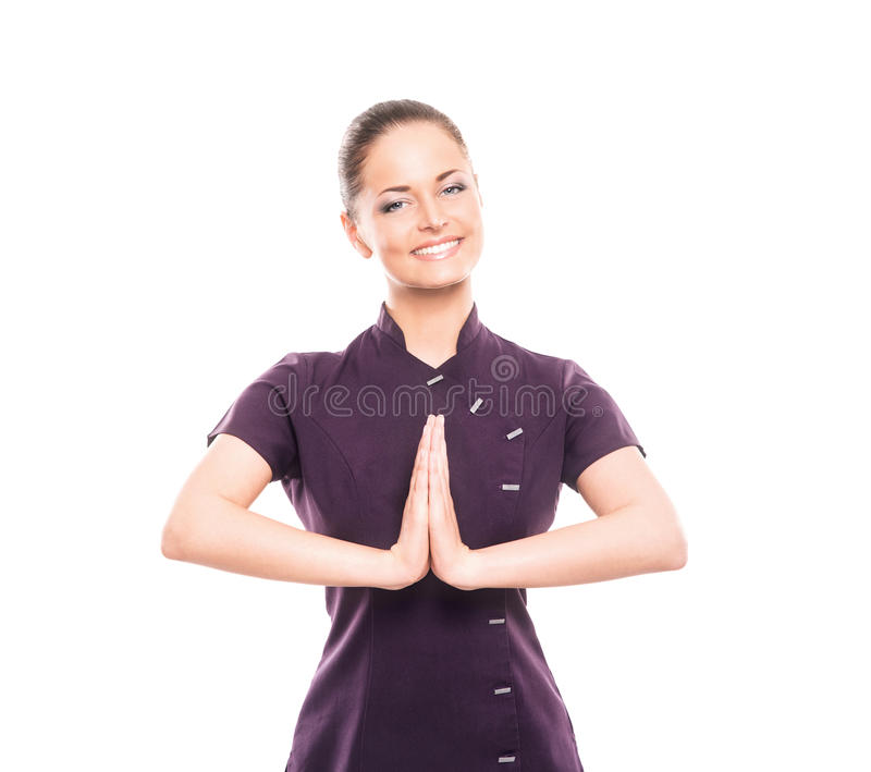 A young and happy woman in a purple uniform. Young, happy and attractive girl in a uniform isolated on white (massage worker or sushi waiter robe royalty free stock photography