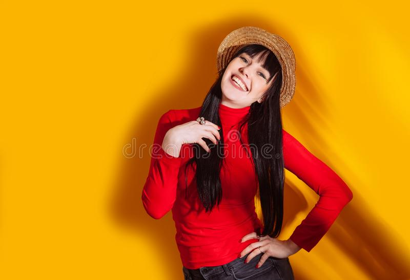 Girl hat sun light shadow tropical yellow orange young woman background red dress tropic royalty free stock images