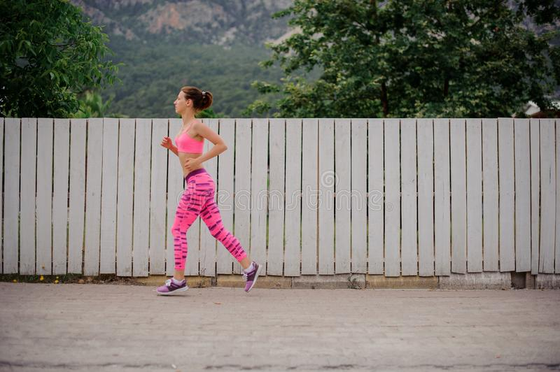 Young happy woman running to the new life in the morning royalty free stock images