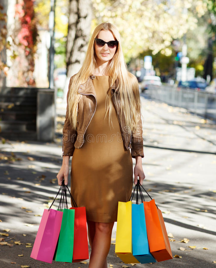 Download Young Happy Woman With Shopping Bags Royalty Free Stock Photo - Image: 28534515