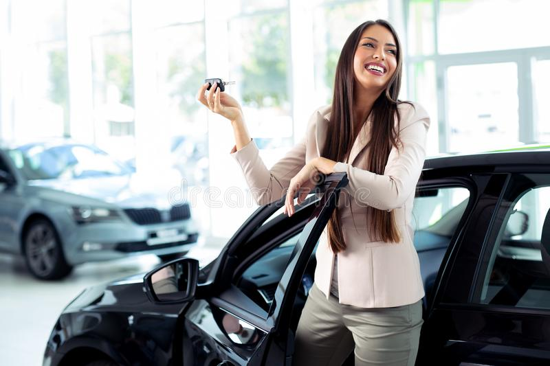 Young Happy Woman Showing The Key Of New Car stock photography
