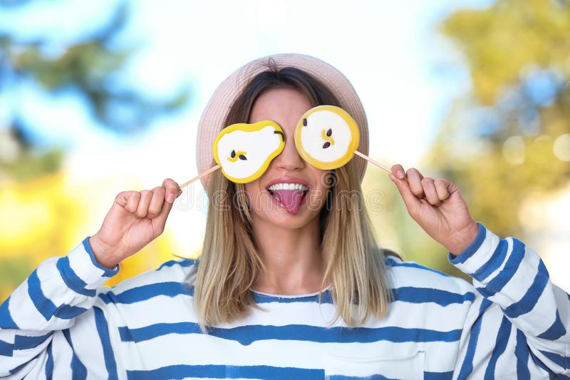 Young happy woman with sweet candies royalty free stock image