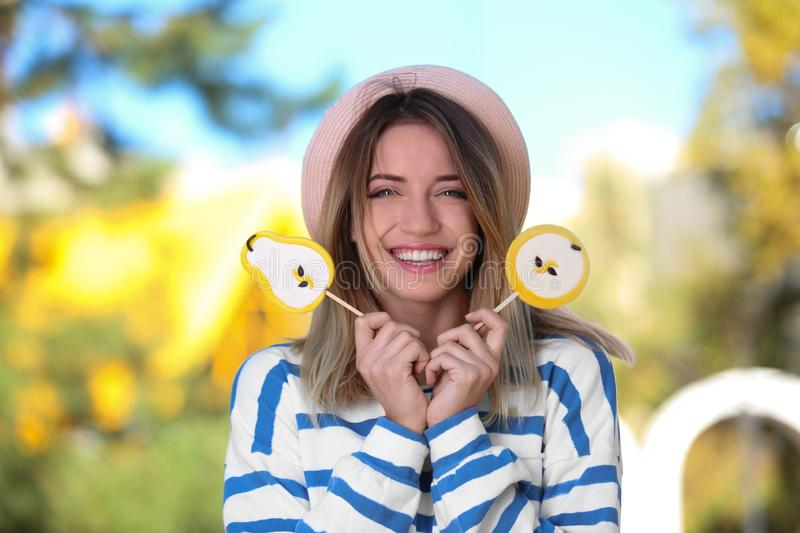 Young happy woman with sweet candies stock photos