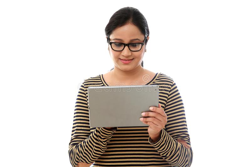 Young happy Woman using a tablet computer against white royalty free stock photography