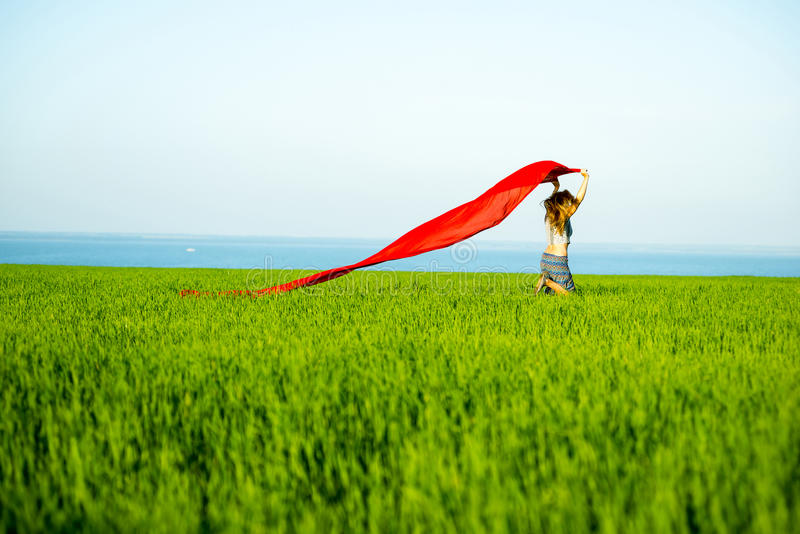 Young happy woman in wheat field with fabric. Summer lifestyle royalty free stock images