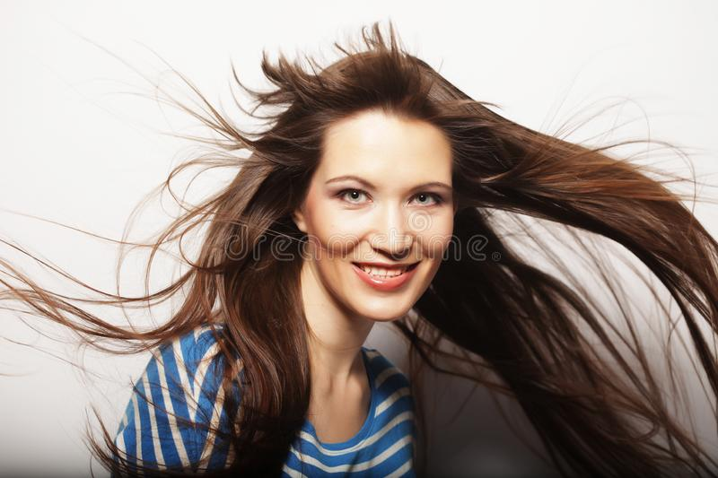 Young woman with wind in hair. Young happy woman with wind in hair stock image