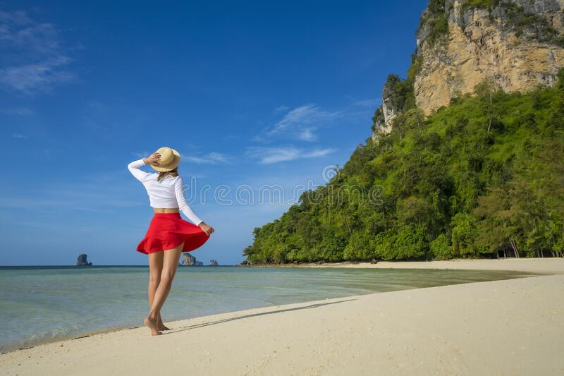Young happy women on tropical beach at summer vacation. Thailand. Young happy woman on tropical beach at summer vacation. Thailand royalty free stock image