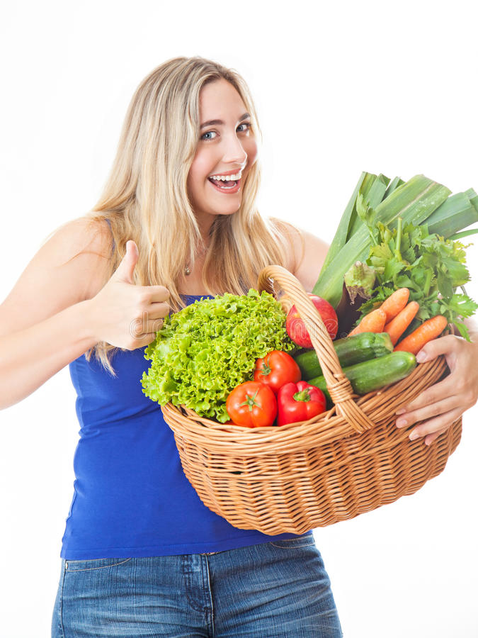 Young healthy beautiful woman with a basket full of fresh vegetables stock photos