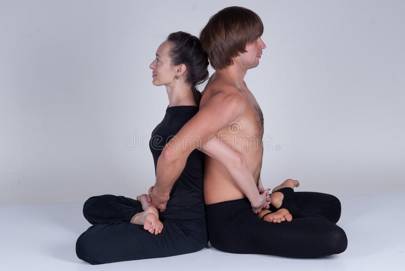 Young healthy couple in yoga position, Man and woman royalty free stock photography