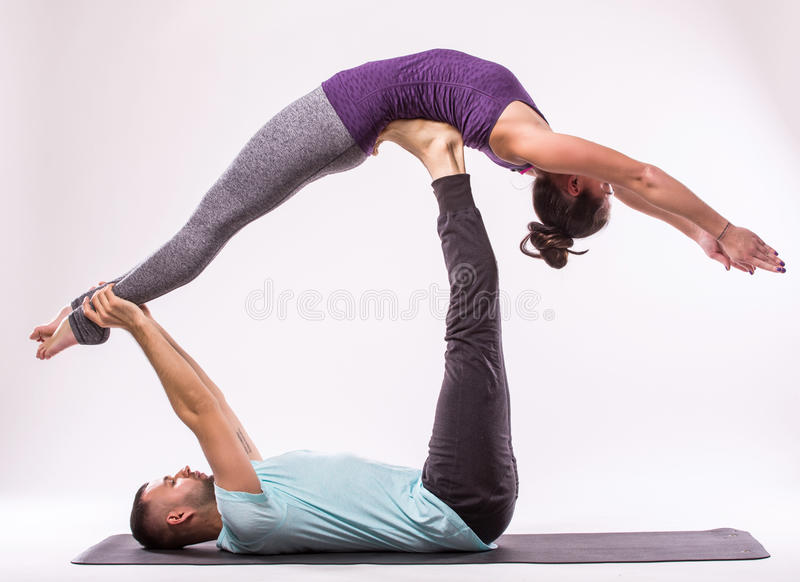 young healthy couple in yoga position stock photo image of posture human 63112848. Black Bedroom Furniture Sets. Home Design Ideas