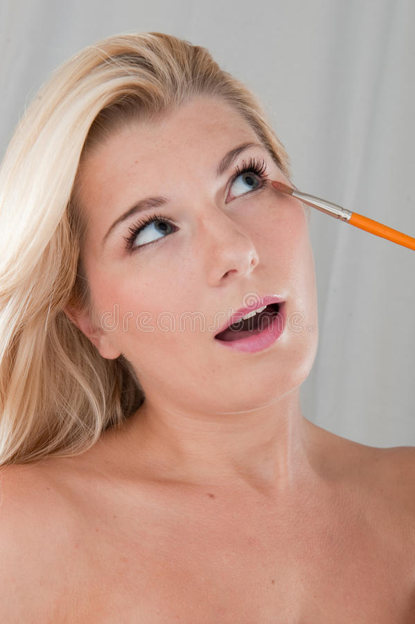 Download Young Healthy Woman Doing Eye Make-up With A Brush Stock Photo - Image: 11825598