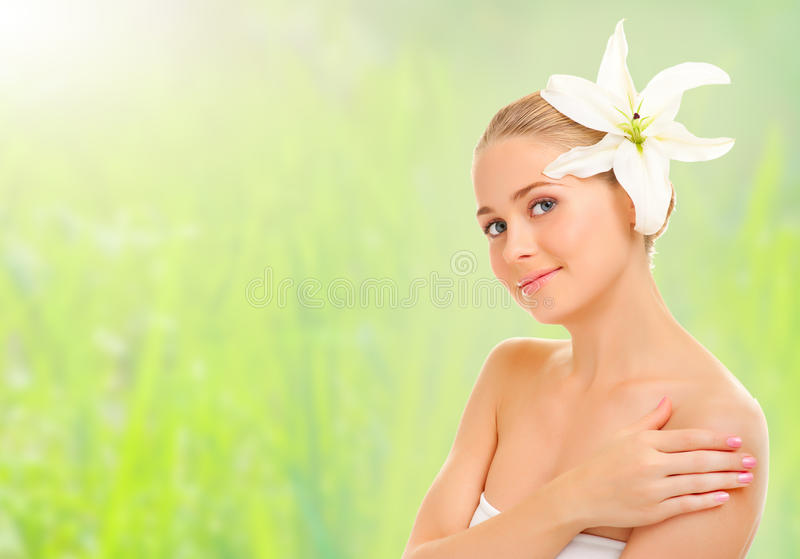 Young Healthy Woman With Flower Stock Photo