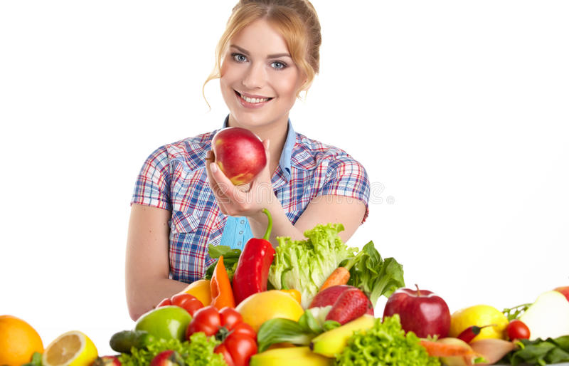 Young healthy woman with fruits and vegetables. stock images