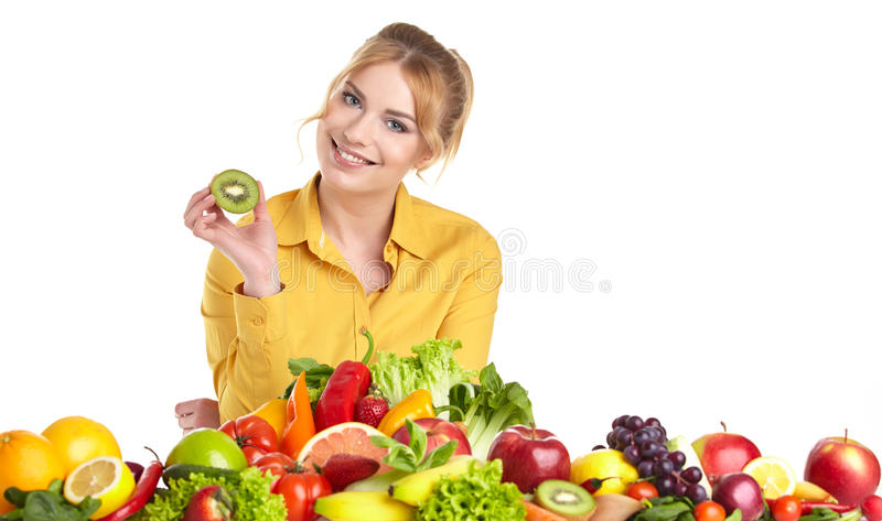 Young healthy woman with fruits and vegetables. royalty free stock image
