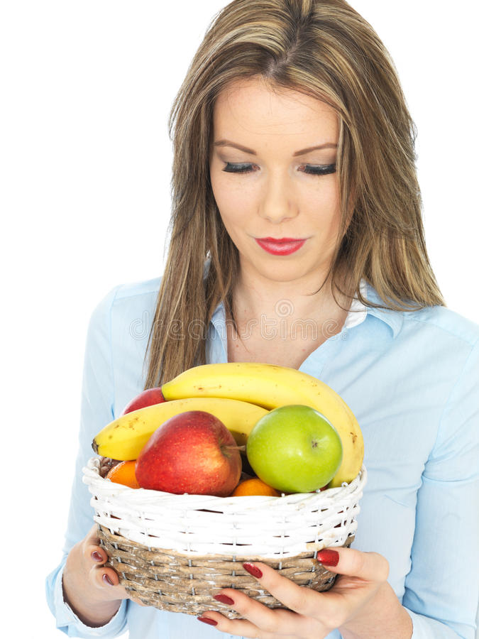 Young healthy Woman Holding a Fresh Basket of Fruit royalty free stock images