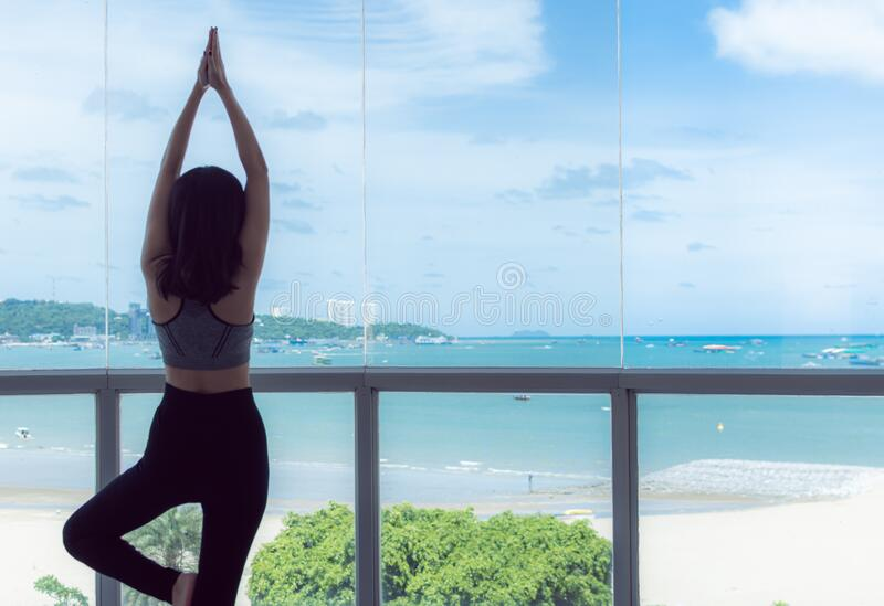 A young healthy woman is practicing Yoga royalty free stock photography