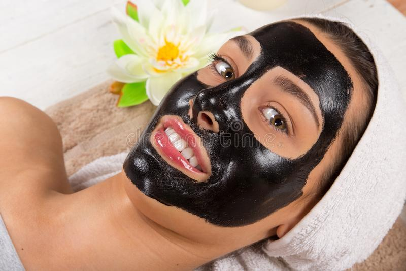 Young healthy woman with black face mask. Young healthy woman in spa making treatments and black face mask stock photography