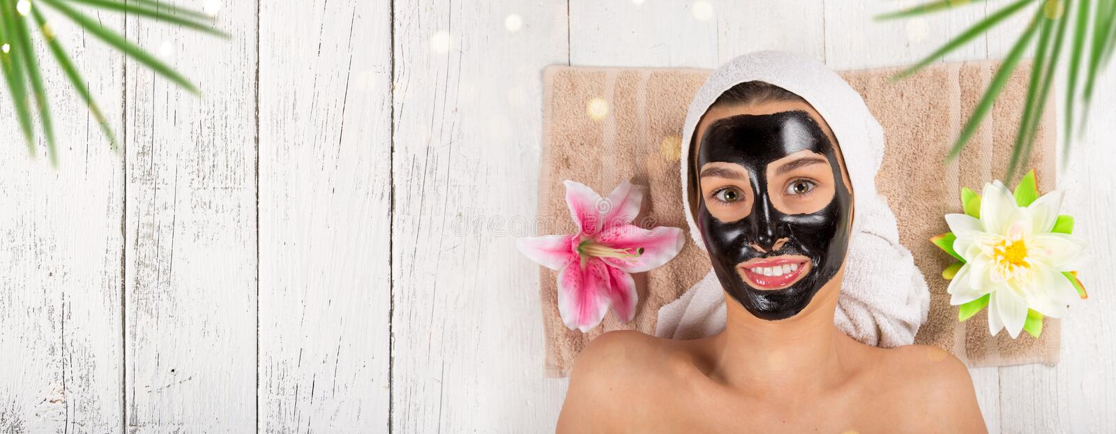 Young healthy woman with face mask. Young healthy woman in spa making treatments and face mask royalty free stock photo