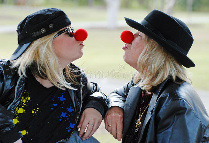 Young at heart mature & young women acting silly royalty free stock photos
