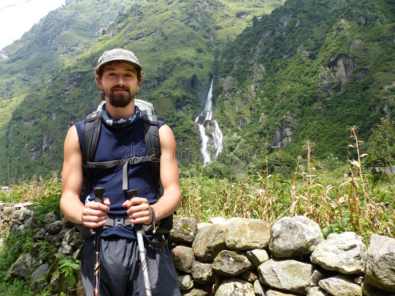 Young hiker. Hiker in Nepal. Waterfalls in Tal village - Annapurna Circuit trek stock photography