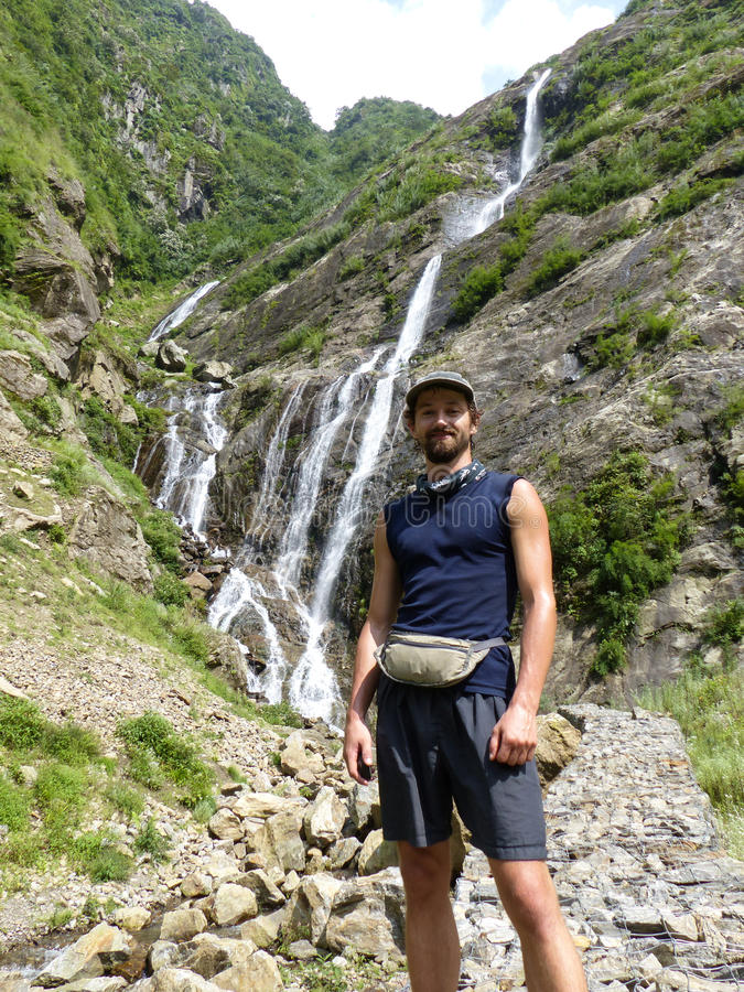 Young hiker. Hiker in Nepal. Waterfalls in Tal village - Annapurna Circuit trek royalty free stock photo