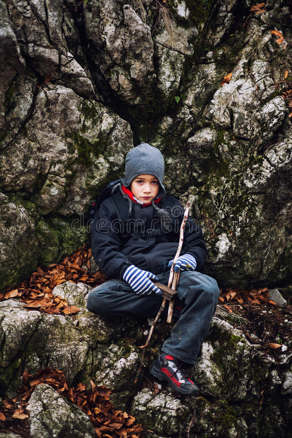 Young hiker resting stock photography